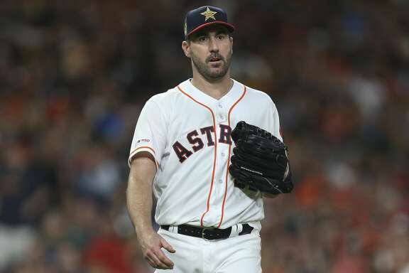 Houston Astros starting pitcher Justin Verlander (35) heads to the dugout after finishing the seventh inning of the MLB game against the Los Angeles Angels at Minute Maid Park on Friday, July 5, 2019, in Houston. Verlander allowed four runs, including three home runs in seven innings.