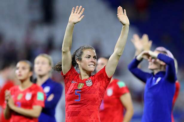 LYON, FRANCE - JULY 02: Kelley O'hara of the USA celebrates following her sides victory in the 2019 FIFA Women's World Cup France Semi Final match between England and USA at Stade de Lyon on July 02, 2019 in Lyon, France. (Photo by Elsa/Getty Images)