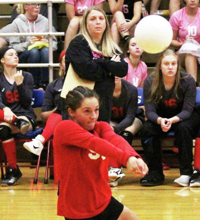 Staunton coach Jeanene Lucykow (back) watches Bulldogs libero Hollie Bekeske make a dig during the Macoupin County Tourney on Oct. 6 in Carlinville. Lucykow led Staunton to a 30-7-1 record to earn 2018 Telegraph Small-Schools Coach of the Year honors. Photo: Greg Shashack / The Telegraph