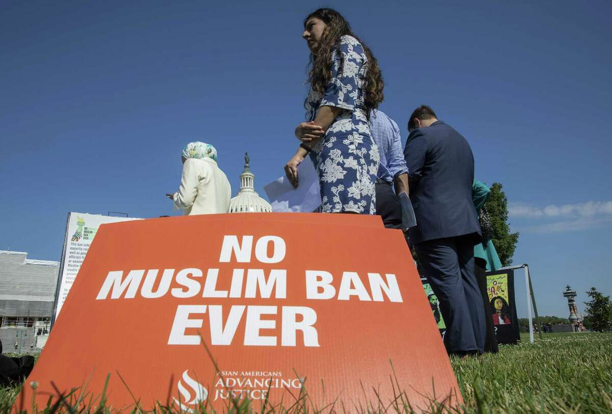 Activists protest on the anniversary of the Supreme Court's ruling upholding the Trump administration's restriction of travel to the U.S. from predominantly Muslin countries, on Capitol Hill June 26, 2019 in Washington, DC. The Court in a 5-4 ruling upheld a third version of the ban, which has also been applied to countries not predominantly Muslim.