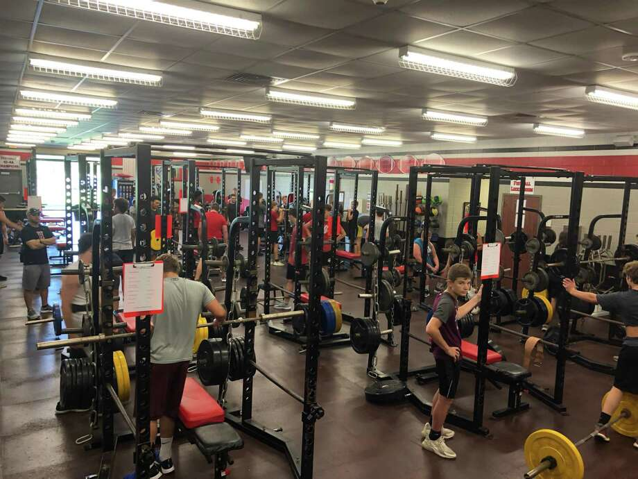 Hargrave boys lift weights during the July 3 session of Falcon Athletic Training Camp Photo: Elliott Lapin