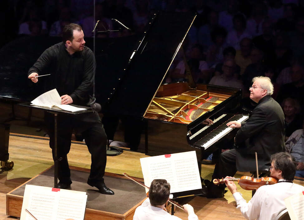 Emanuel Ax, right, joins the BSO and Andris Nelsons for Mozart's Piano Concerto No. 22 on July 5 2019 at Lenox, Mass.