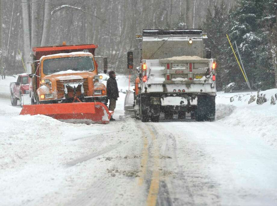Two snowplow drivers stop to talk on North Salem Road in Ridgefield, Conn, during Thursday's snowstorm, February 9, 2017. Photo: H John Voorhees III / Hearst Connecticut Media / The News-Times