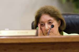 Castle Hills Councilwoman Lesley Wenger listens to a resident speak at a meeting July 1. Wenger was arrested Thursday and charged with tampering with evidence.