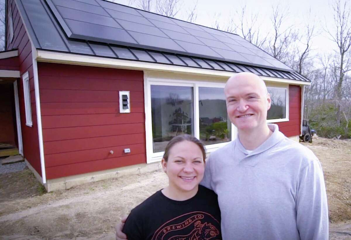Carla Waclawski and Sean Holmes stand outside their Higgganum home, designed and built by Wolfworks.