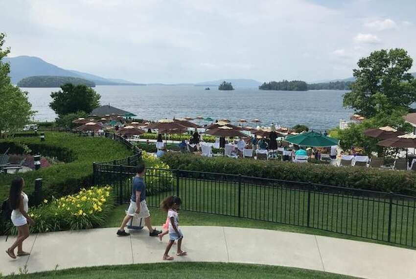 The Fund for Lake George is working to keep the lake clean. Tourists, pictured here, enjoy the lake view from The Sagamore on July 6 2019 in Bolton Landing, N.Y.