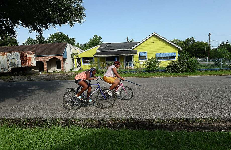 Abandoned properties marked for demolition fill a portion of 10th Street in Port Arthur, which is concerned that its population decline, that saw a further decrease in the wake of Tropical Storm Harvey, will dip below 50,000. The low population level could effect city funding. Photo taken Wednesday, July 3, 2019 Kim Brent/The Enterprise Photo: Kim Brent / The Enterprise / BEN