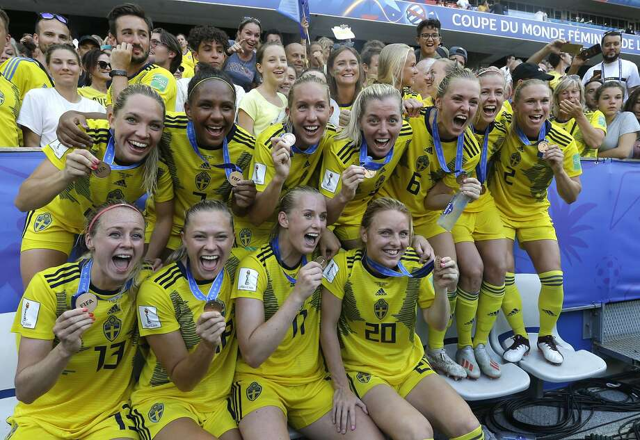 Sweden players celebrate with their bronze medals after beating England 2-1 in Nice, France. Photo: Claude Paris / Associated Press