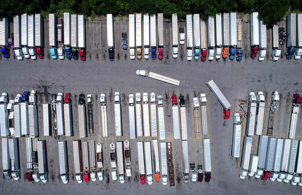 Trucks sit parked at Love's Travel Stop, near Interstate 45 and Patton Street, on July 5 north of downtown Houston. The truck stop property will be used for storm detention as part of plans to rebuild I-45 in the area.