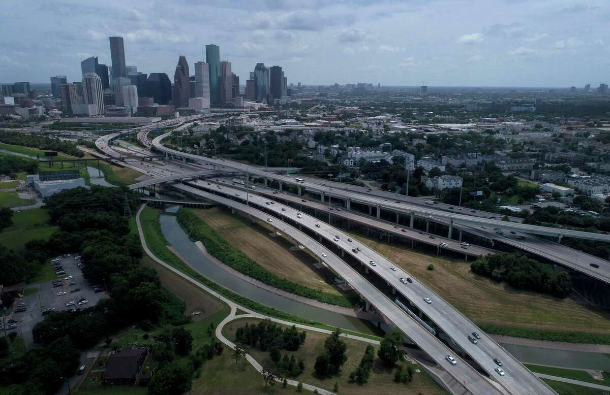 Traffic moves along where Interstate 45, left, and Interstate 10 diverge as they cross White Oak Bayou north of downtown Houston on July 5.