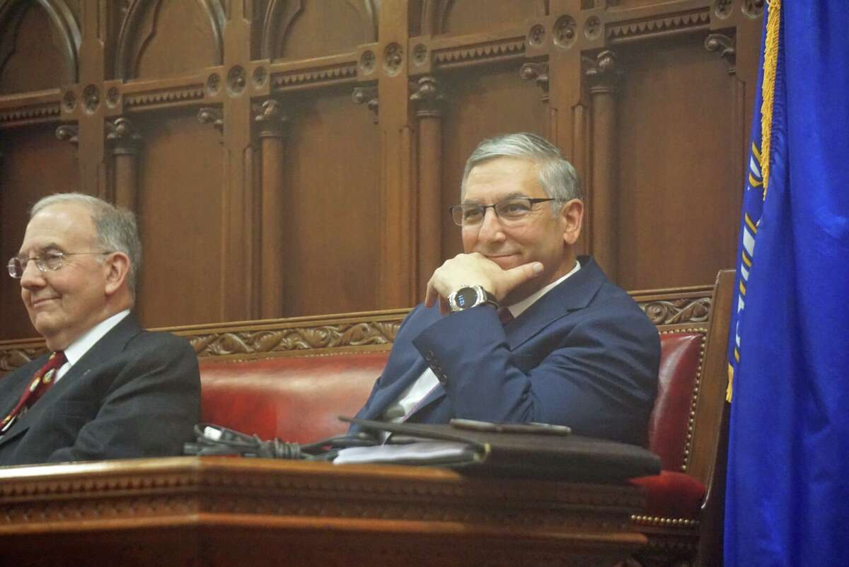 Senate Republican Leader Len Fasano, R-North Haven, right, sat with Senate President Pro Tempore Martin Looney, D-New Haven, leaving a space between them at the close of the 2018 legislative session in the early hours of Thursday May 10, 2018 at the Capitol in Hartford, Conn.