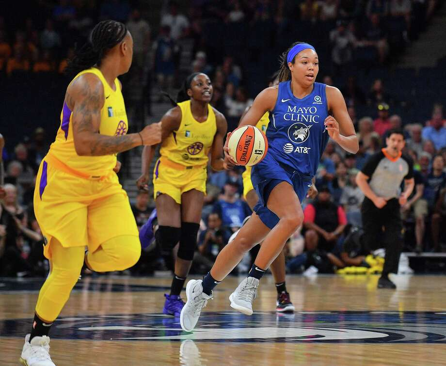 The Minnesota Lynx's Napheesa Collier (24) brings the ball up the court against the Los Angeles Sparks on June 8. Photo: Sam Wasson / Getty Images / 2019 Sam Wasson 2019 Sam Wasson