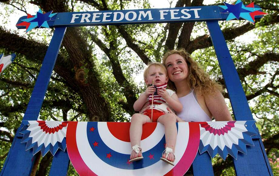 Paige Brown takes a photo with her 15-month-old niece, Presley, during the Montgomery Fourth of July parade, Saturday, July 6, 2019, in Montgomery. Photo: Jason Fochtman, Houston Chronicle / Staff Photographer / Houston Chronicle