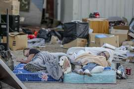 Ronnie Tolbert, left, and her husband Danny, sleep on a mattress in the front yard of their home that was severely damaged in a 7.1 magnitude earthquake, on Saturday, July 6, 2019, in Trona, Calif. (Robert Gauthier/Los Angeles Times/TNS)