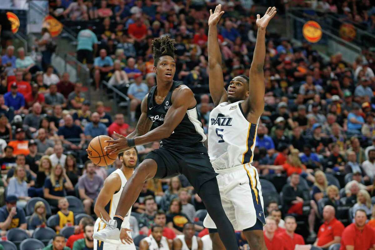 Spurs guard Lonnie Walker IV, left, continued his stellar play in the summer league. Walker scored 28 points in 23 minutes.