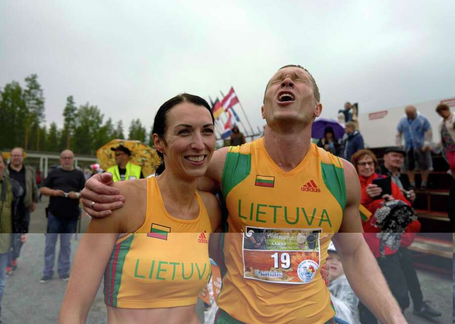 "Lithuanian couple Vytautas Kirkliauskas, right, and Neringa Kirkliauskiene celebrate their victory in the wife carrying race, a 278-yard obstacle course, during the 24th world championships in Sonkajarvi, Finland, Saturday, July 6, 2019. Despite the event's name couples don't have to be married, and organizers say male contestants could ""steal a neighbor's wife"" if they didn't have a female companion. (AP Photo/David Keyton) Photo: David Keyton / Copyright 2019 The Associated Press. All rights reserved."