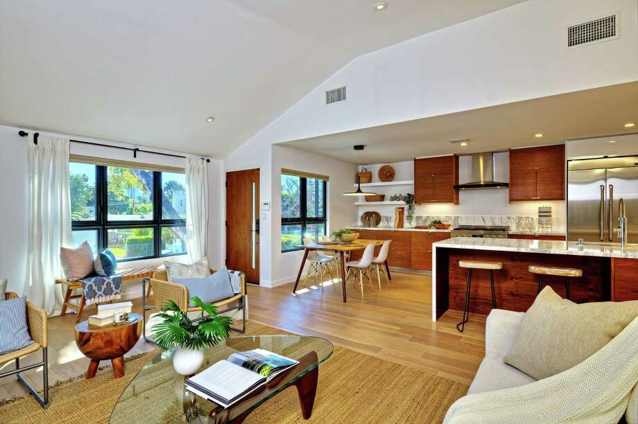 """""""This Is Us"""" star Chris Sullivan paid $2.333 million for an updated two-story in Venice's Oxford Triangle neighborhood. The contemporary-vibe house features wood siding along the exterior and an interior with crisp white walls and white oak floors. Designed for coastal living, sliding glass doors open to expansive decking with a built-in barbecue. (Ron Luxemburg) Photo: Ron Luxemburg / Los Angeles Times"""