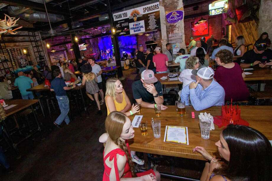 Guests and sponsiors mingle as bands perform during Fire Up the Bands Saturday, July 6, 2019 at Pacific Yard House in Conroe. Photo: Cody Bahn, Houston Chronicle / Staff Photographer / © 2019 Houston Chronicle