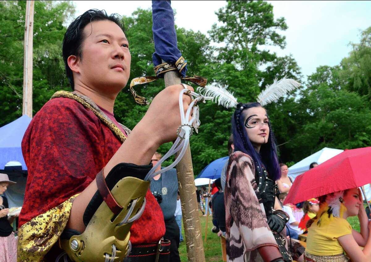 Jae Brobchu, of Meriden, and Ariella Notarile, of Prospect, wait to enter the Field of Honor to fight, during the annual Midsummer Fantasy Renaissance Faire at Warsaw Park in Ansonia, Conn., on Saturday July 6, 2019. The fair continues Sunday from 11 a.m. to 6 p.m.