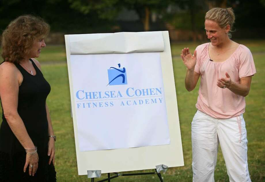 Chelsea Cohen's mom Barbara Rittner, left, and soccer star Kristine Lilly unveil the logo for the Fairfield County Sorts Commission's Chelsea Cohen Fitness Academy during a press conference outside Norwalk City hall on Sunday, June 27, 2010. The logo features the color Carolina blue, the color used by Lilly's alma mater the University of North Carolina, a school the Cohen had also wanted to attend. Photo: Brian A. Pounds, ST / Connecticut Post