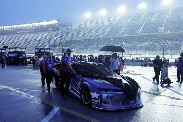 Chase Elliott's crew pushes his car back to the garage area after the NASCAR Cup Series auto race was postponed because of rain at Daytona International Speedway, Saturday, July 6, 2019, in Daytona Beach, Fla. The race was rescheduled for Sunday. (AP Photo/Terry Renna)