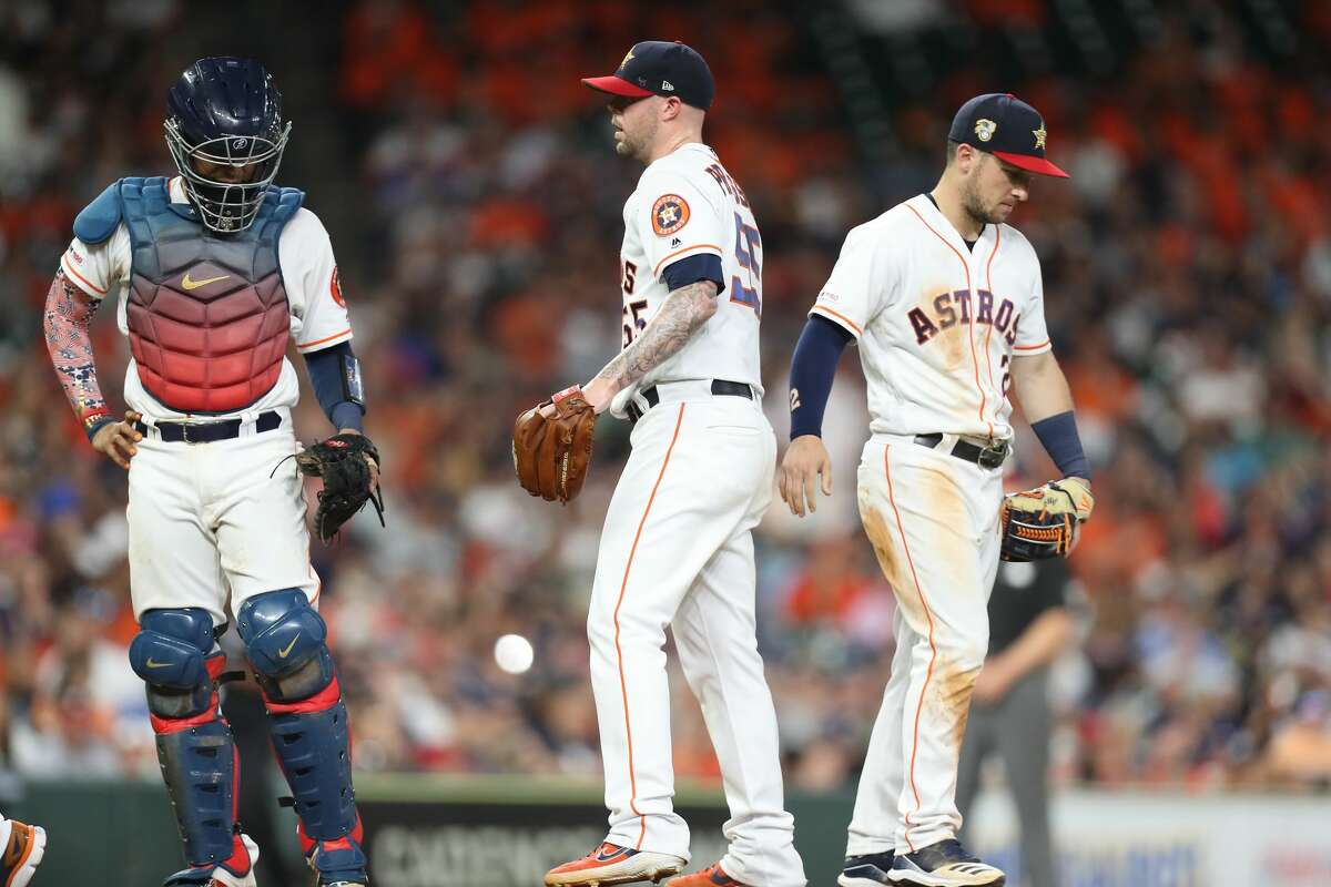 Houston Astros relief pitcher Ryan Pressly (55) rans into some problems during the 8th inning of an MLB baseball game at Minute Maid Park Saturday, July 6, 2019, in Houston.