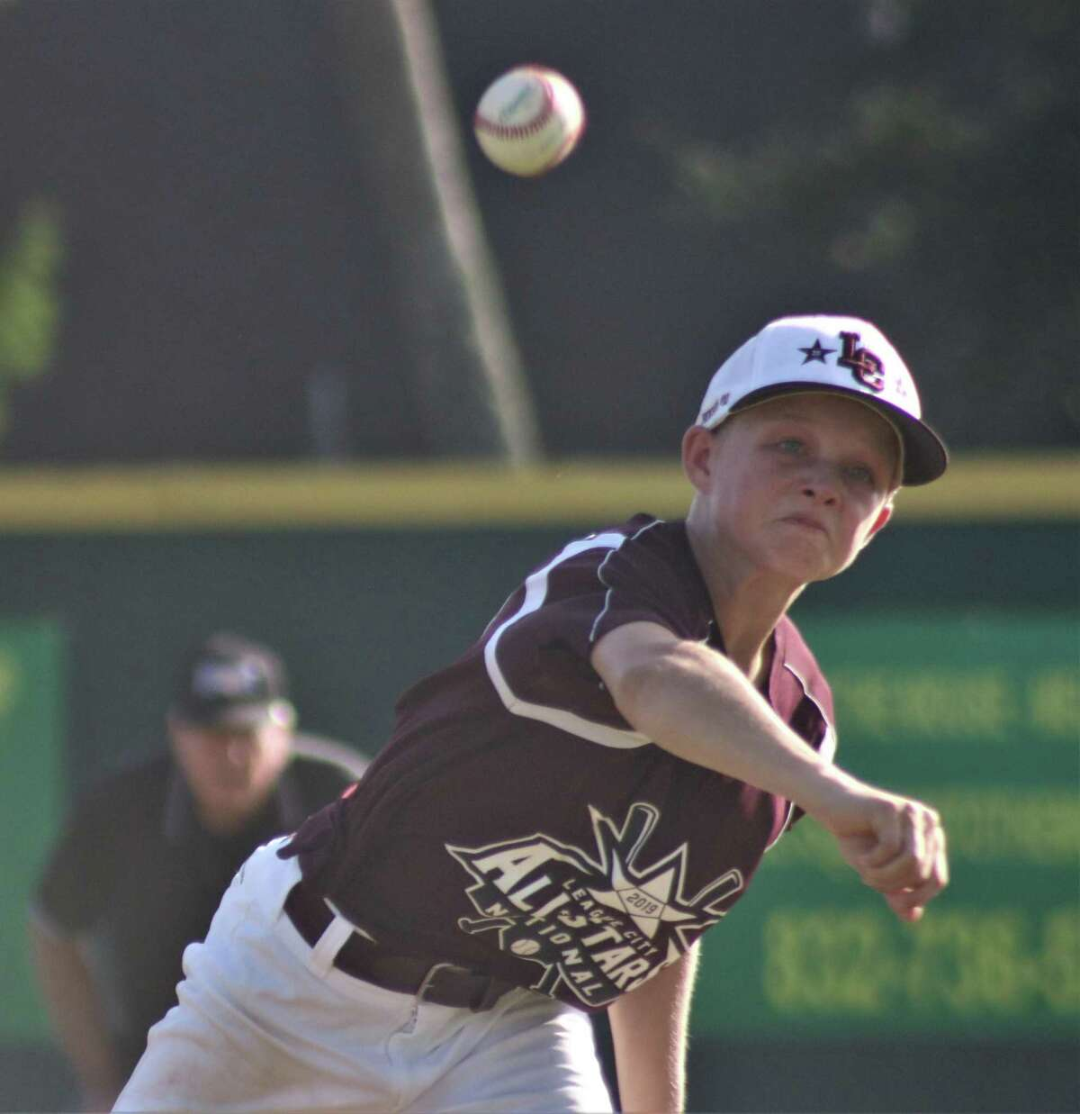 League City National pitcher Jacob Newsom works on a Post Oak batter in the fifth inning Saturday night. Newsom was the losing pitcher despite not allowing any earned runs.