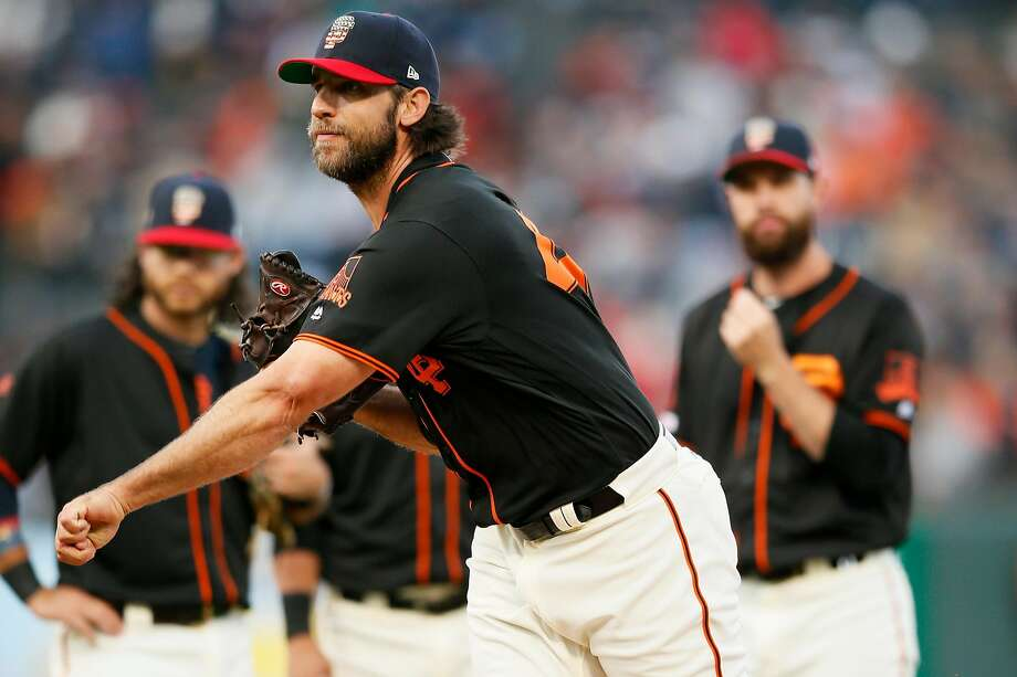 San Francisco Giants starting pitcher Madison Bumgarner (40) takes practice pitches after he was checked for a possible injury in the 1st inning of an MLB game against the St. Louis Cardinals at Oracle Park on Saturday, July 6, 2019, in San Francisco, Calif. Bumgarner was hit by a comeback pitch to his left arm. Photo: Santiago Mejia / The Chronicle