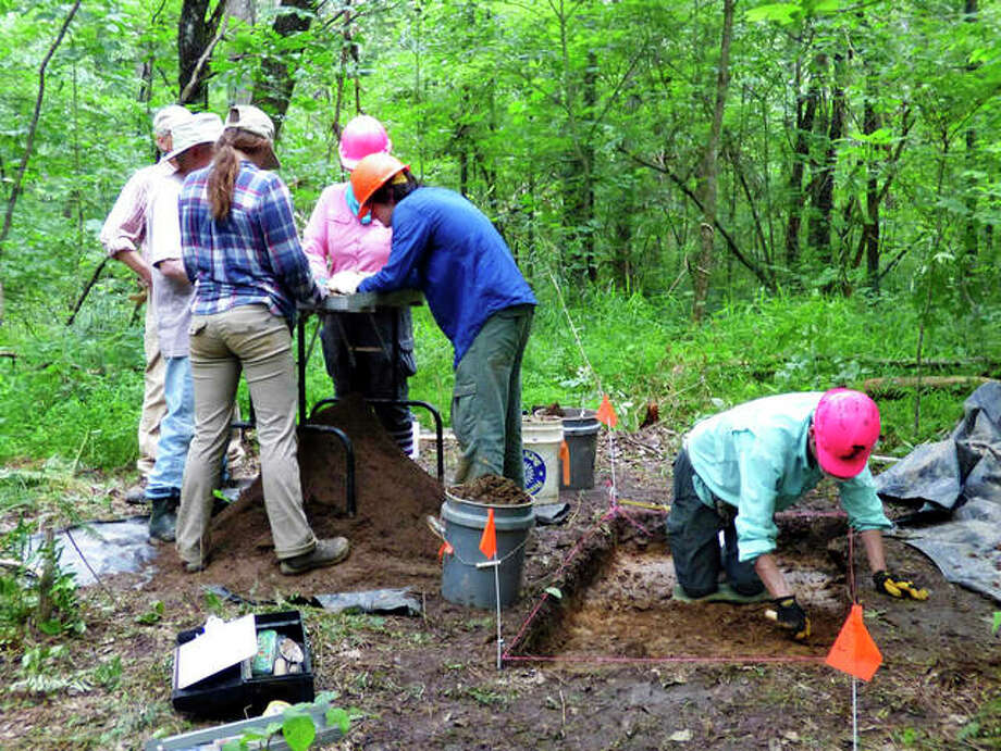 Southern Illinois University student Kevin Cabrera( far right) digs at an archaeology site in Shawnee National Forest while Noah Mills and Rebekah Mills, Ray Meininger and Jessi Spencer sift through what he collected. Photo: Marilyn Halstead | Southern Illinoisan (AP)