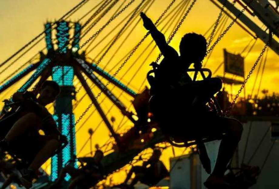 Fair-goers enjoy a sunset ride at the 2018 Jersey County Fair.