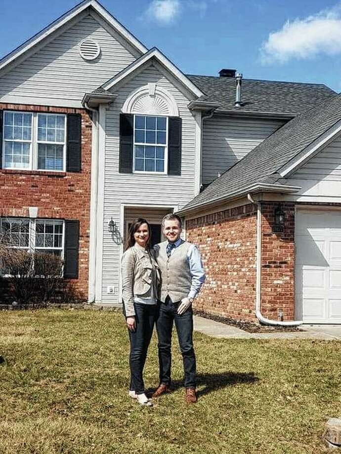 Haley Myrick (left) and her husband, Alex, celebrate moving into their new house.