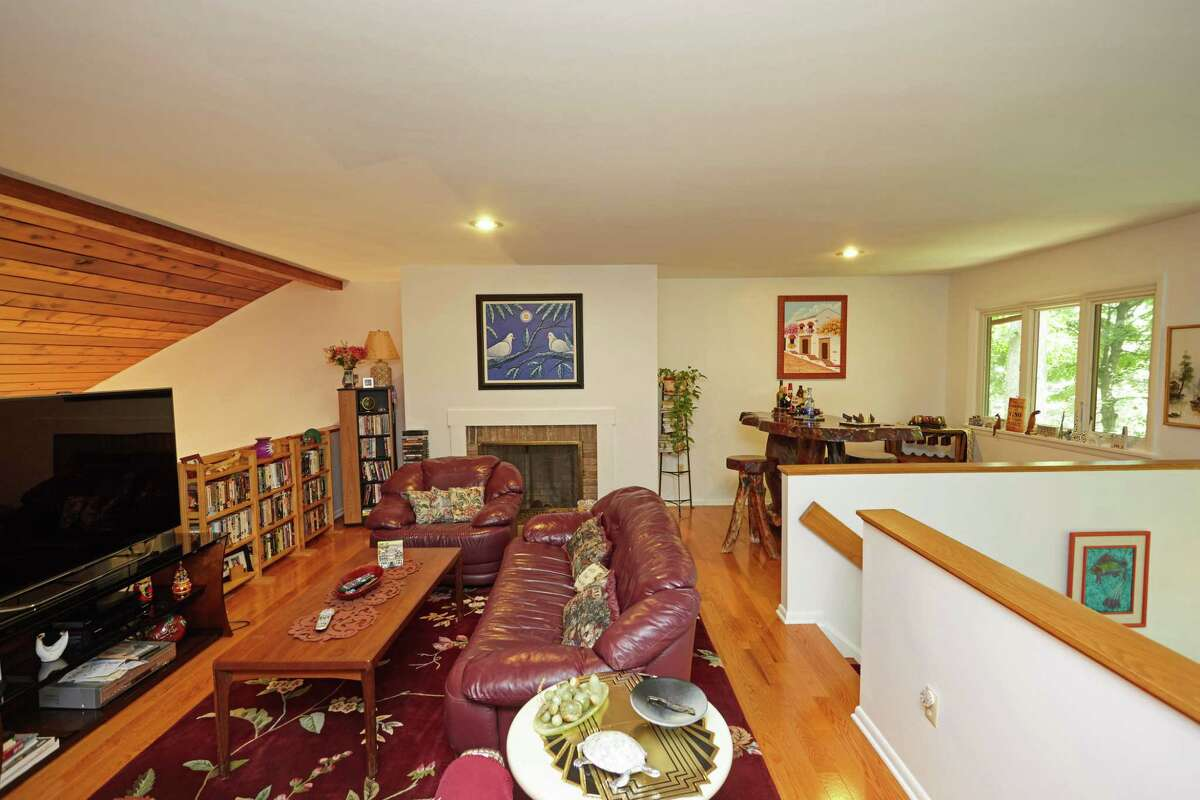 The second floor family room has a fireplace and interior balcony that looks down into the foyer and living room.