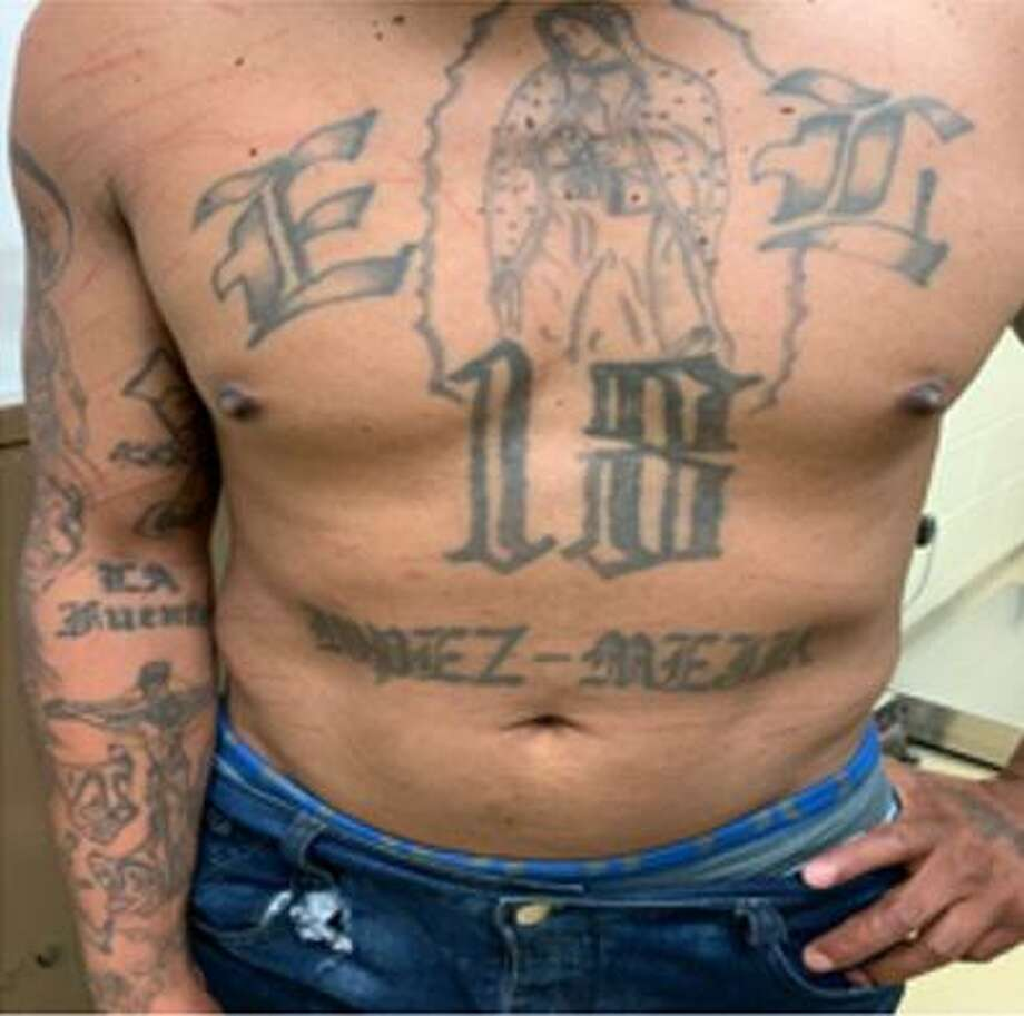 Tattoos related to the 18th Street gang are shown on the torso of a wanted member arrested June 28 by agents from the Hebbronville Border Patrol station. Photo: Courtesy Photo /U.S. Border Patrol