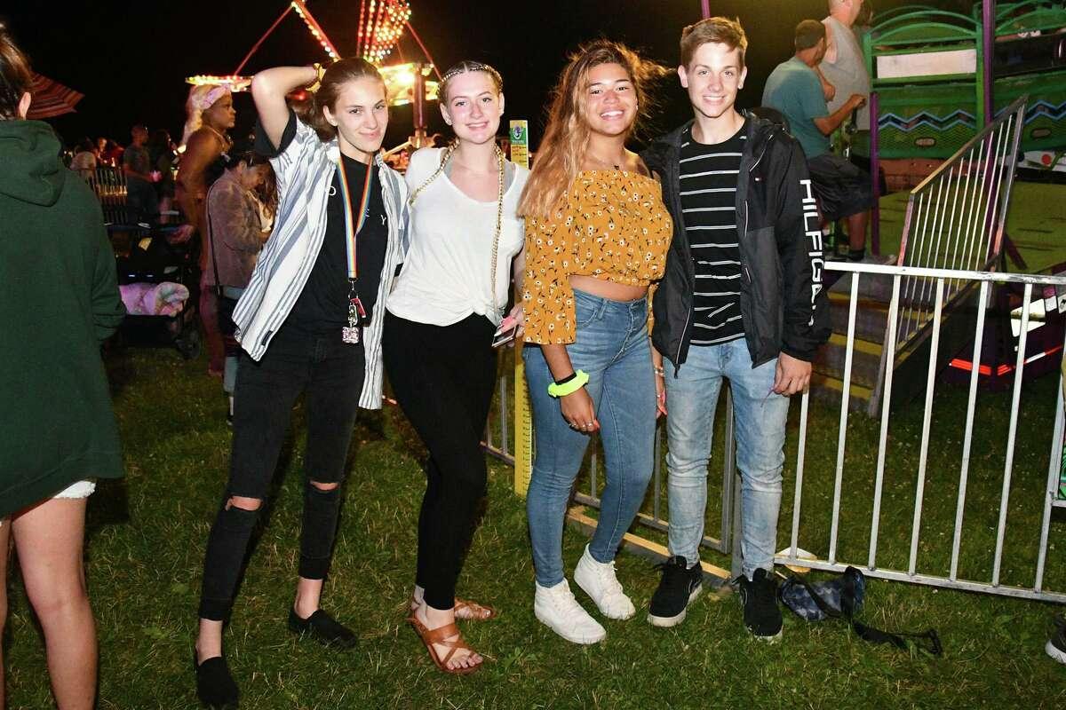 Above, Tessa Cannavo, Eva Ciarcia, Angie Abreau and Noah Phelps strike a pose during the carnival.