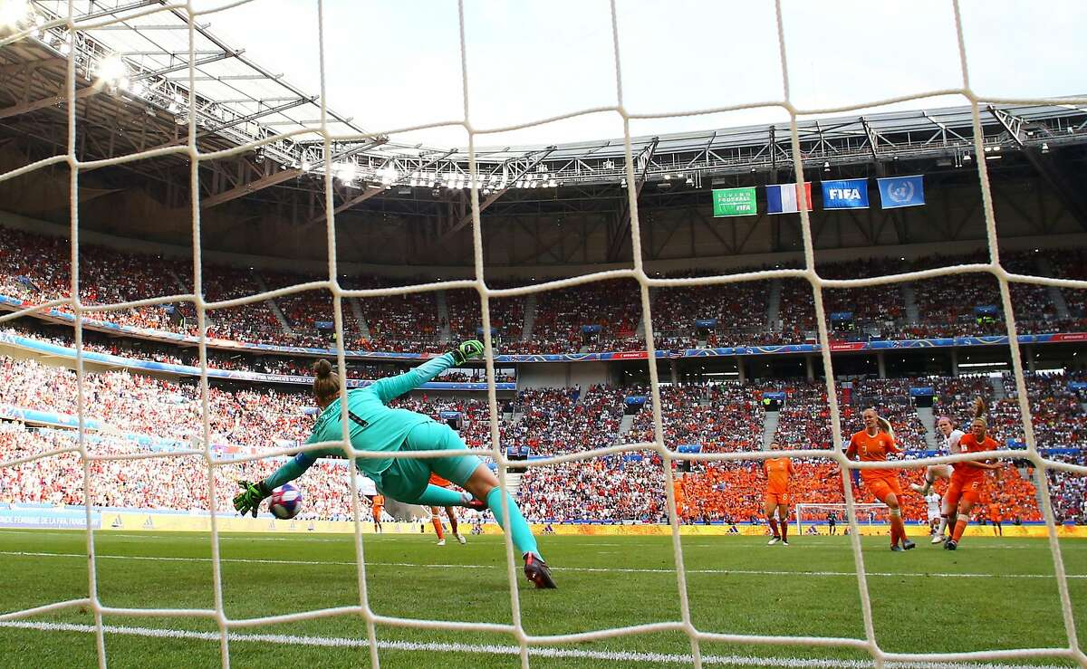 LYON, FRANCE - JULY 07: Sari Van Veenendaal of the Netherlands reaches for the ball as Rose Lavelle of the USA scores her team's second goal during the 2019 FIFA Women's World Cup France Final match between The United States of America and The Netherlands at Stade de Lyon on July 07, 2019 in Lyon, France. (Photo by Richard Heathcote/Getty Images)
