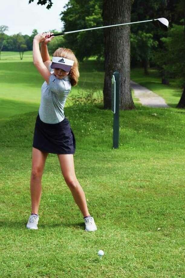 FMCHS sophomore, Ellie Hyten, practices her tee shots at Oak Brook Golf Club in Edwardsville. Photo: Tyler Pletsch | The Intelligencer
