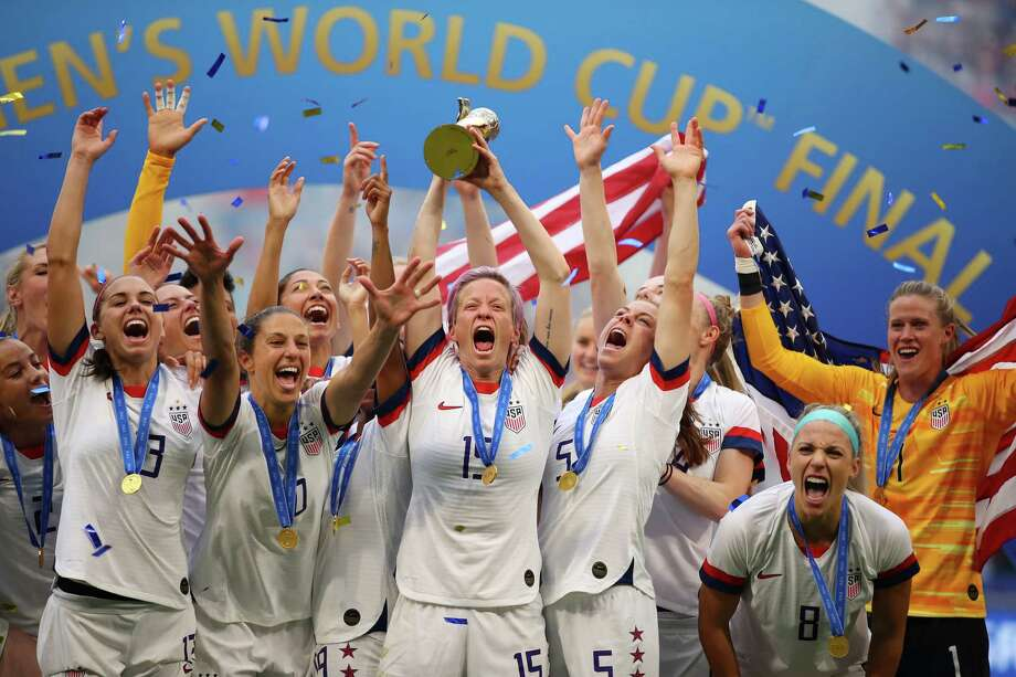 PHOTOS: Everything you should know about Megan Rapinoe  LYON, FRANCE - JULY 07:  Megan Rapinoe of the USA lifts the FIFA Women's World Cup Trophy following her team's victory in the 2019 FIFA Women's World Cup France Final match between The United States of America and The Netherlands at Stade de Lyon on July 07, 2019 in Lyon, France.  >>>Get to know more about United States soccer star Megan Rapinoe ...  Photo: Richard Heathcote, Getty Images / 2019 Getty Images
