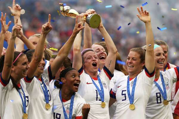 United States' Megan Rapinoe holds the trophy celebrating at the end of the Women's World Cup final soccer match between US and The Netherlands at the Stade de Lyon in Decines, outside Lyon, France, Sunday, July 7, 2019. The US defeated the Netherlands 2-0. (AP Photo/Francisco Seco)