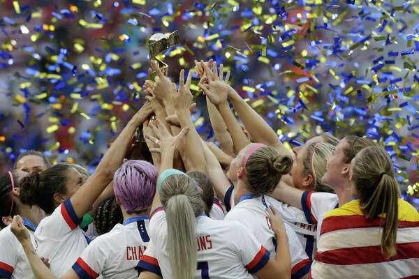 United States' team celebrates with the trophy after winning the Women's World Cup final soccer match between US and The Netherlands at the Stade de Lyon in Decines, outside Lyon, France, Sunday, July 7, 2019. (AP Photo/Claude Paris)