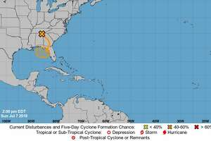 A trough of low pressure over the South may turn into a tropical system, according to the National Hurricane Center.