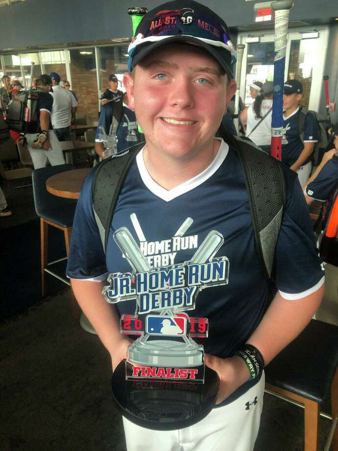 Karsen Luther of Conroe poses with his MLB Jr. Home Run Derby trophy from his competition at Progressive Field in Cleveland on Saturday July 6, 2019. Photo: Submitted Photo