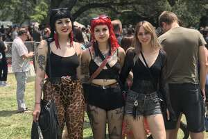 Lacy fishnets tights, leopard print skinny jeans and fringe earrings make up the goth-rockabilly style seen on a group of fans.