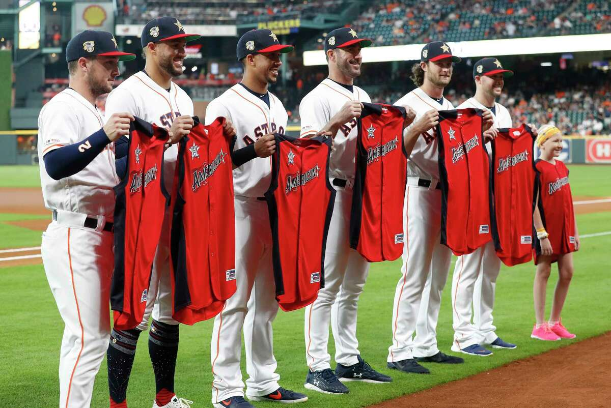 Houston Astros All-Stars Alex Bregman (2), George Springer (4), Michael Brantley (23), Justin Verlander (35), Gerrit Cole (45), and pitcher Ryan Pressly (55) before the start of the first inning of an MLB game at Minute Maid Park, Sunday, July 7, 2019, in Houston.