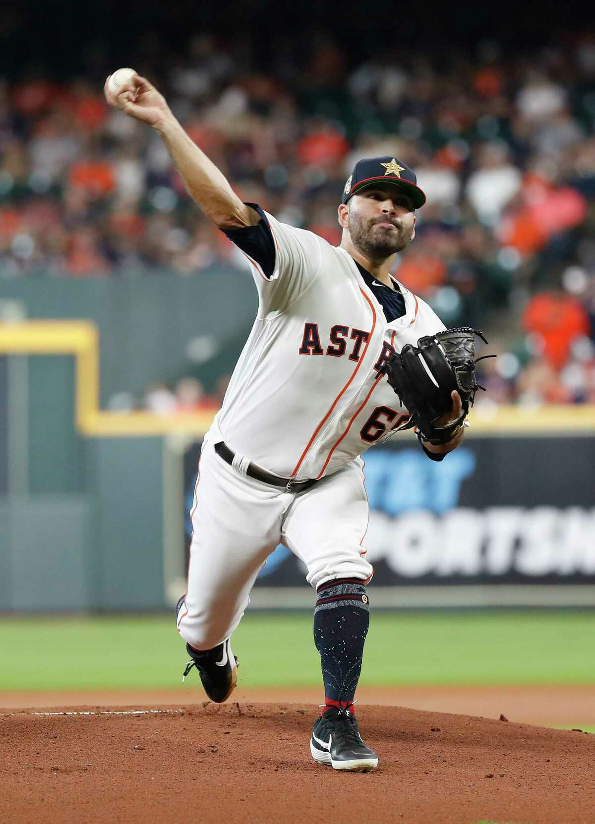 Houston Astros starting pitcher Jose Urquidy (65) pitches during the first inning of an MLB game at Minute Maid Park, Sunday, July 7, 2019, in Houston.