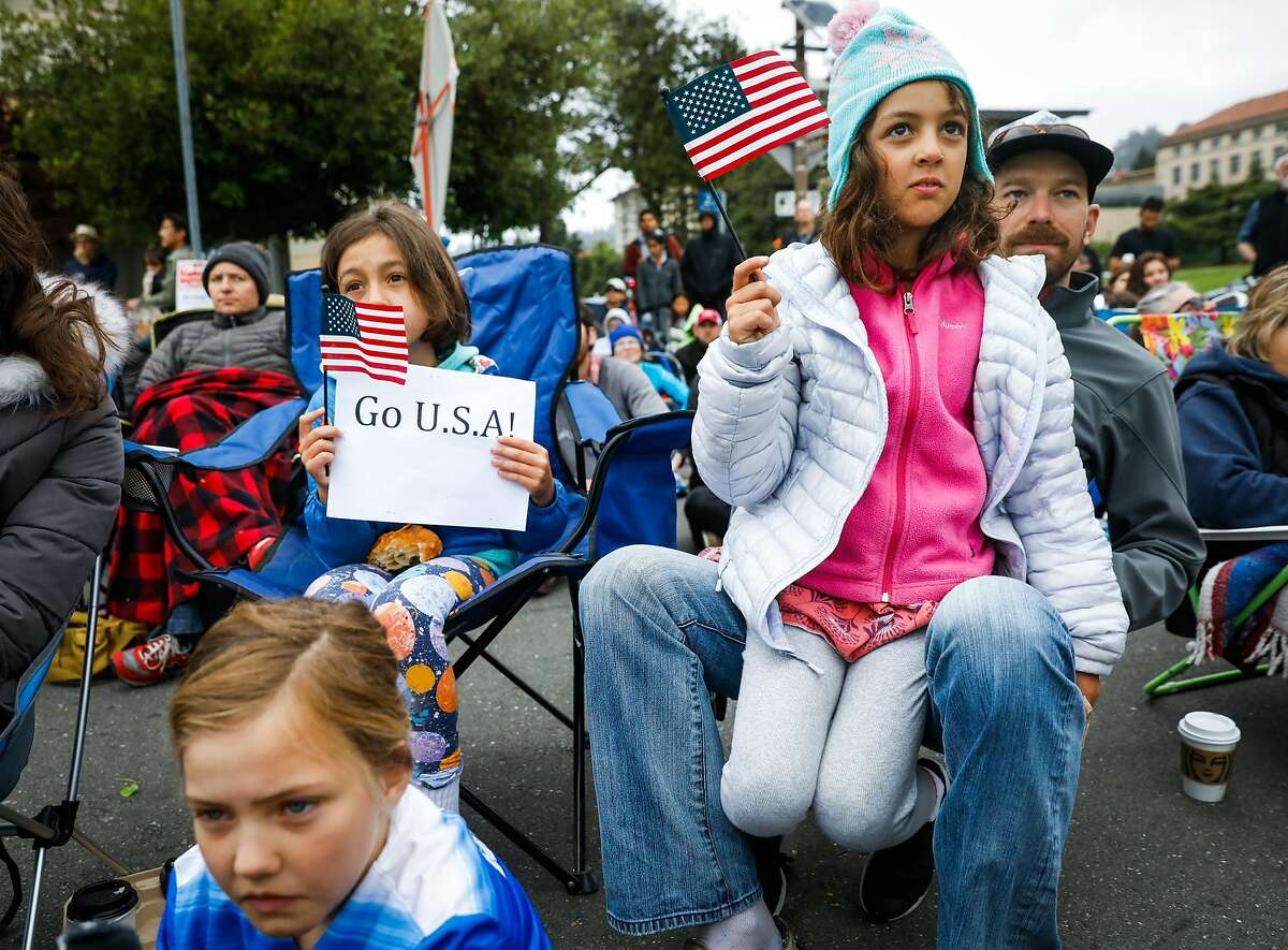 (l-r) Fans Fallon Marston- Chakan 7, Mayssa Harrati, 8, her sister Nayla Harrati, 7 and Ben Dominigue watch the FIFA Women's World Cup Finals between USA and Netherlands in Berkeley, California, on Sunday, July 7, 2019. USA defeated the Netherlands 2-0.
