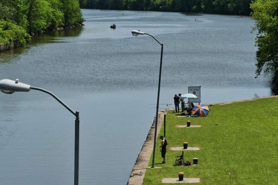 People fish on the Mohawk River near Lock 7 on the Erie Canal on Sunday, July 7, 2019, in Niskayuna, N.Y.  (Paul Buckowski/Times Union) Photo: Paul Buckowski, Albany Times Union / (Paul Buckowski/Times Union)