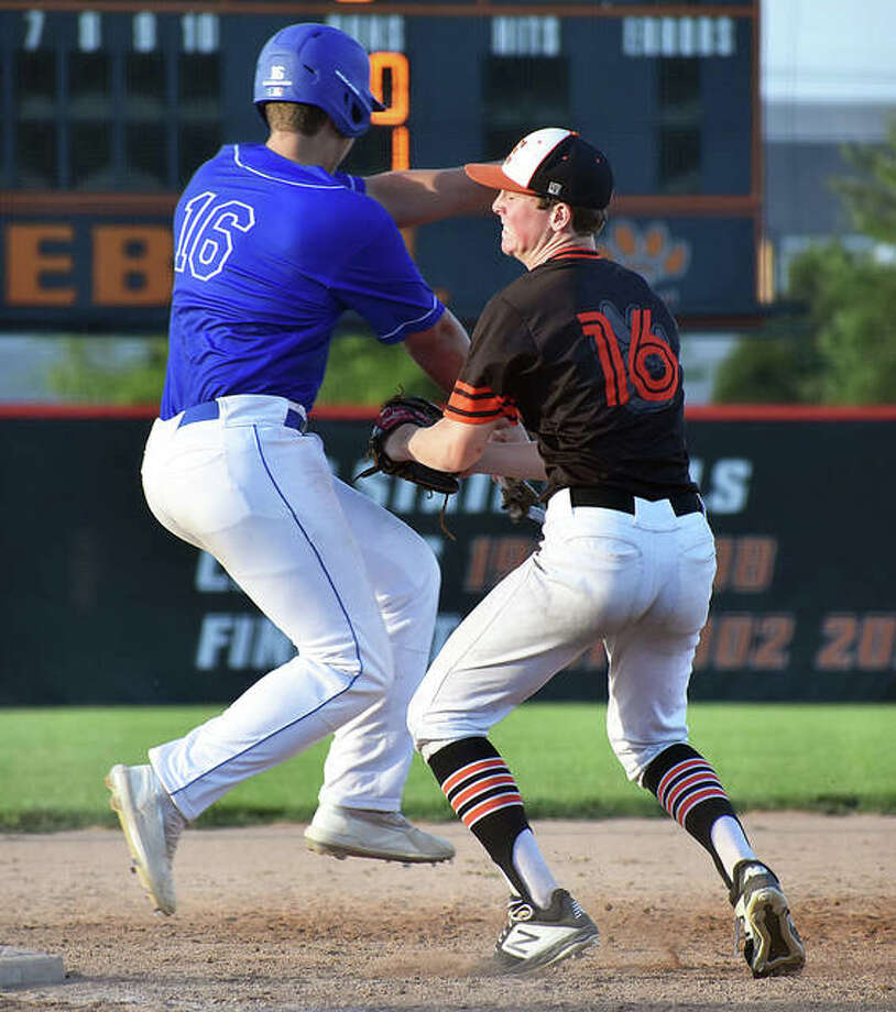 Edwardsville shortstop Evan Funkhouser tags out a Rawlings Extreme runner near third base on Saturday. Photo: Matt Kamp|The Intelligencer