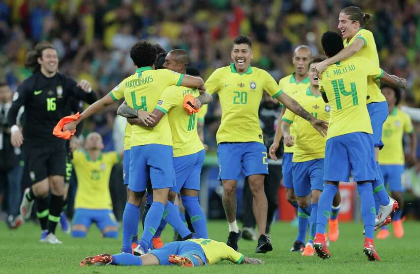 Brazil's players celebrate their 3 -1 victory over Peru in the final match of the Copa America at Maracana stadium in Rio de Janeiro, Brazil, Sunday, July 7, 2019.