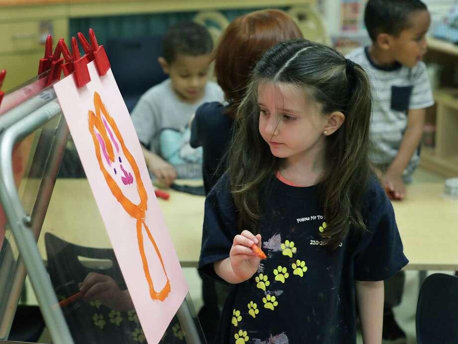 Lillian Jones paints a picture in class at the Pre-K 4 SA North Center last March. Photo: Bob Owen /San Antonio Express-News / ©2019 San Antonio Express-News