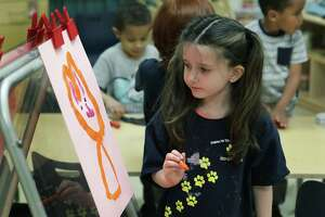 Lillian Jones paints a picture in class at the Pre-K 4 SA North Center last March.